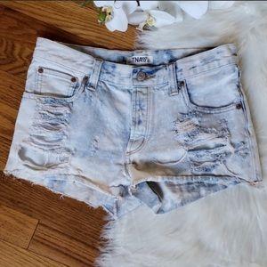 TNA Aritizia white wash distressed denim shorts